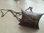 Tiny metal purse