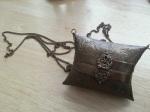 Tiny metal purse